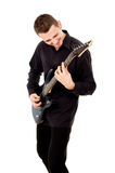 A beautiful boy with electric guitar plays Stock Image