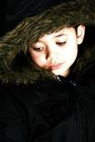 Beautiful boy in fake fur hooded jacket. Royalty Free Stock Images