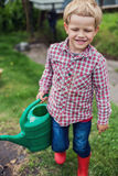 Beautiful boy gardening. Garden. Vegetables. Royalty Free Stock Images
