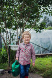 Beautiful boy gardening. Garden. Vegetables Stock Photo