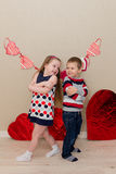 Beautiful boy and girl on the background of hearts Stock Image