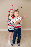 Beautiful boy and girl on the background of hearts Royalty Free Stock Photos