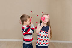 Beautiful boy and girl on the background of hearts Royalty Free Stock Photo