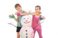 Beautiful boy and girl with hands in paint near color snowman with colored horns and hands Stock Images
