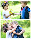 Beautiful boy and girl in a park, boy giving flowers to the girl. Boy and girl in a park, boy giving flowers to the girl Stock Image