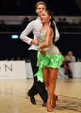 Beautiful boy and girl perform during dancesport competition Royalty Free Stock Image