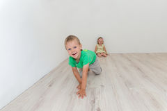 Beautiful boy and girl sitting on the floor Royalty Free Stock Photo
