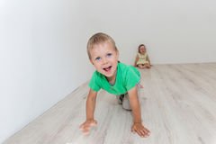 Beautiful boy and girl sitting on the floor Royalty Free Stock Image