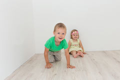 Beautiful boy and girl sitting on the floor Stock Image