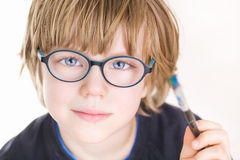 Beautiful boy with glasses and painting brush in hand. Beautiful boy with glasses and painting brush in his hand Stock Photos