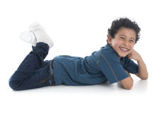Beautiful Boy Laying Down stock images