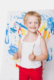 Beautiful boy painting with paintbrush on canvas. Education. Creativity Stock Photos