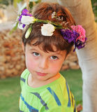 Beautiful boy posing in the garden Royalty Free Stock Photo