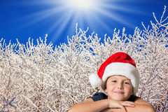 Beautiful boy in red hat of Santa-Claus Royalty Free Stock Images