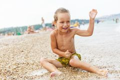 Beautiful boy and the sea Royalty Free Stock Photos