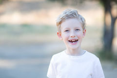 Beautiful boy. Smiling boy showing his teeth, emotion concept Royalty Free Stock Photography