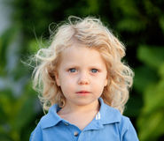 Beautiful boy three year old with long blond hair Royalty Free Stock Images