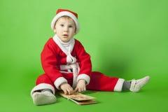 Beautiful boy wearing Santa costume Royalty Free Stock Photography