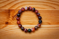 Beautiful bracelet agate stone beads on the table, the top view Stock Images