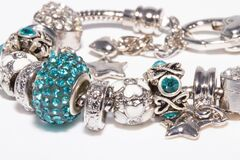 Beautiful bracelet with charms isolated on white background