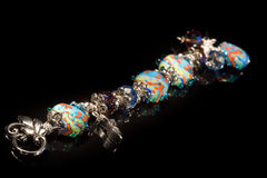 Beautiful bracelet of colored glass and silver Stock Image