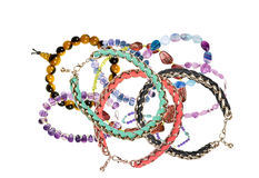 Beautiful bracelets with precious stones isolated on white Royalty Free Stock Photo