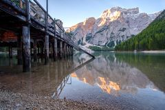 Beautiful Braies lake and house in the background of Seekofel mountain Pragser Wildsee. Beautiful Braies lake and house in the background of Seekofel mountain in stock image