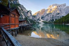Beautiful Braies lake and house in the background of Seekofel mountain Pragser Wildsee. Beautiful Braies lake and house in the background of Seekofel mountain in stock photos
