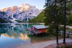 Beautiful Braies lake and house in the background of Seekofel mountain Pragser Wildsee. Beautiful Braies lake and house in the background of Seekofel mountain in stock photography