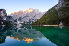 Beautiful Braies lake and house in the background of Seekofel mountain Pragser Wildsee. Beautiful Braies lake and house in the background of Seekofel mountain in royalty free stock photo