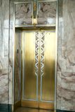 Art deco brass elevators. These beautiful brass art deco elevators are in the Adams building of the Library of Congress in Washington, DC. Art Deco, which Royalty Free Stock Photography