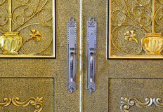 Beautiful brass door with aluminium handle Royalty Free Stock Image