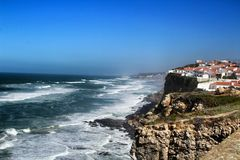 Brave sea and cliffs of the coast of Azenhas do Mar in Portugal. Beautiful brave sea and cliffs of the coast of Azenhas do Mar in Portugal in Spring nature stock photo