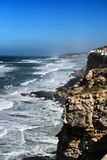 Brave sea and cliffs of the coast of Azenhas do Mar in Portugal. Beautiful brave sea and cliffs of the coast of Azenhas do Mar in Portugal in Spring nature royalty free stock images