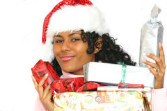 Beautiful brazilian girl. In christmas outfit with lots of presents Stock Photography