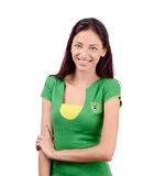 Beautiful Brazilian girl. Attractive girl with Brazilian flag on her green t-shirt. Isolated on white Royalty Free Stock Photography