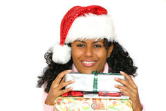Beautiful brazilian girl with santa hat. Beautiful brazilian girl with presents and wearing a santa hat Royalty Free Stock Photos