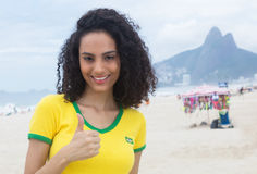 Beautiful brazilian sports fan with curly hair at Rio de Janeiro Royalty Free Stock Photo