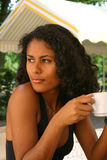 Beautiful brazilian woman drinking coffee Royalty Free Stock Image
