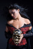 Beautiful brazilian woman holding a skull Stock Photos