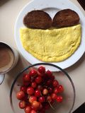 Beautiful Breakfast with Cherries, Omelette  and Toast Stock Photo