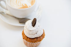 Beautiful breakfast cupcake and cup of aromatic coffee Stock Photos
