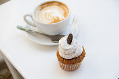 Beautiful breakfast cupcake and cup of aromatic coffee Royalty Free Stock Image