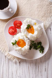 Beautiful breakfast: eggs Orsini and coffee vertical top view Royalty Free Stock Photography