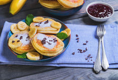 Beautiful breakfast frieds banana fritter decorated additives Stock Photo