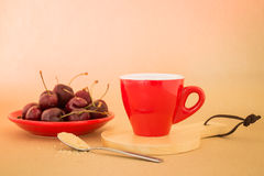 Beautiful breakfast of red coffee cup and cherries Royalty Free Stock Photo