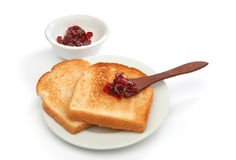 A beautiful breakfast scene. Two toast on a plate with red jam behind. Deliciuos food for breakfast.  Look at my gallery for more meals Stock Images