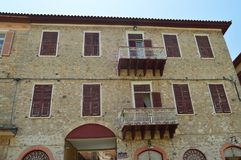 Beautiful Brick Buildings Light Brown With Nice Red Windows In Nauplion. Architecture, Travel, Landscapes, Cruises. stock photos