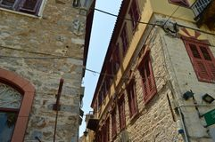 Beautiful Brick Buildings Light Brown With Nice Red Windows In Nauplion. Architecture, Travel, Landscapes, Cruises. stock photo
