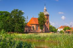 Beautiful brick church in country side, Poland royalty free stock image